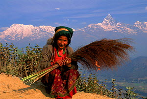 Nepalese woman, Anapurna mountain range in background, Pokhara, Nepal.  -  Pete Oxford
