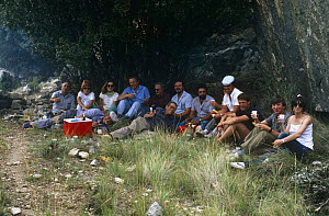 """David Attenborough, shepherds & crew sharing picnic lunch on location for BBC programme """"The First Eden"""", Soria, Spain, June 1986  -  Diana Richards Cronk"""