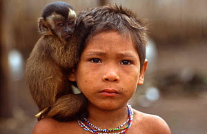 Arara Indian child with capuchin monkey perched on his shoulder. Amazon Basin. Brazil - Martin Dohrn