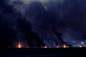 Burning oil wells, Kuwait, Arabia. Post Gulf war.  -  Ross Couper-Johnston