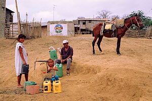Filling water containers, rural water supply project. Pro Pueblo Foundation, Ecuador  -  Pete Oxford