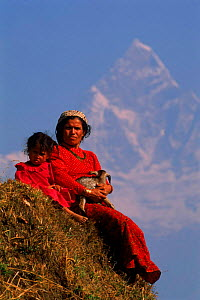 Child and woman with goat kid. Fishtail Mountain in b/ground. Himalayas, Sarangkot, Nepal Annapurna Range  -  Pete Oxford