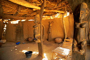 Interior of Dogon house with wooden carvings of women, Mali, North Africa  -  Grant McDowell