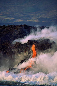 Erruption of parasitic cone, with lava flowing into sea Fernandina Island, Galapagos - Pete Oxford