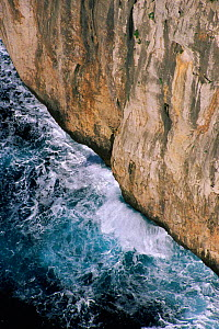 Waves breaking against rock cliff off Cape Formentor, Mallorca, Spain - Martin Gabriel