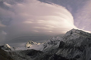 Lenticular clouds forming over the Italian Alps - Martin Dohrn
