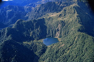 Aerial view of lake amongst tree covered mountains, Peru, South America  2000  -  Robert Fulton