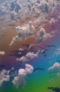 Looking down onf Clouds over Atlantic Ocean with rainbow colours - Phil Savoie