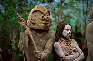 Asaro mudman with wife at traditional dance ceremony, Mount Hagen, Papua New Guinea, 1991 - Phil Chapman
