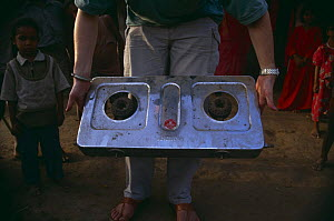 Ecofriendly Biogas cooker, cattle dung is used as fuel (less firewood is taken from NP therefore) village within Bandhavgarh NP, Madhya Pradesh, India  -  Nick Barwick
