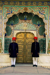 Royal guards standing on duty outside ornate gate to City Palace, Jaipur, Rajasthan, India  -  Ingo Arndt