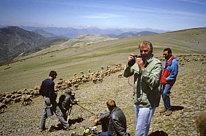 "David Attenborough taking photographs while the film crew set up their equipment. On location in Soria, Spain, filming for the BBC programme ""The First Eden"", 1986  -  Diana Richards Cronk"