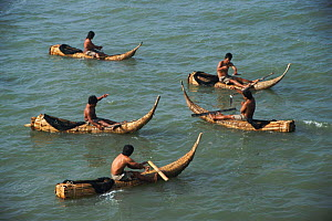 Fishermen in traditional reed boats Pimental, Pacific coast, Peru, South America  -  Karen Bass