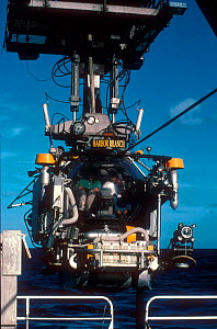 Johnson Sealink II submersible being lowered into the sea - one of the few craft in the world capable of reaching depths of 1,000 metres. Filming for BBC tv series Blue Planet about life in the oceans - David Shale