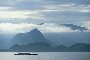 View across sea to Vestvagoy Island in clouds, Lofot Islands, Norway, Europe  -  Christoph Becker