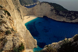 Looking down onto deserted secluded beach and cove, Zakynthos, Greece  -  Staffan Widstrand