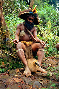 Huli wigman with Cassowary chick, Papua New Guinea 1992  -  John Downer