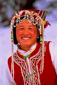 Nosi Yi ethnic woman portrait in summer dress, Mtns north of Lijiang, Yunnan Province, China  -  Pete Oxford