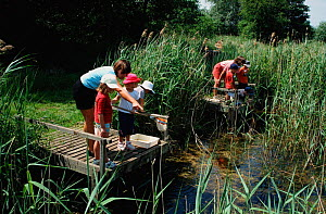 Children pond dipping at Wicken Fen, Cambridgeshire, UK - Martin H Smith