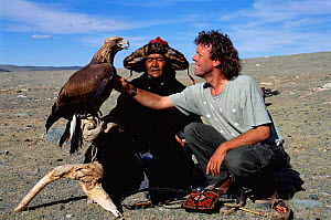 Photographer Pete Oxford with Golden eagle used for hunting by Kazakhs. Tsengel Khairkhan mtn, W Mongolia  -  Pete Oxford