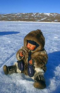 Inuit child wearing traditional caribou and sealskin clothing, Nunavut, Baffin Island, Canadian Arctic  -  Sue Flood
