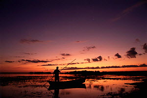 Gaucho poling canoe Ibera Marshes National Reserve, North Argentina, South America  -  Ross Couper-Johnston