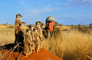 Film-maker Simon King with family of Meerkats {Suricata suricatta} Tswalu Kalahari Reserve, South Africa. 2002. aka Suricate - Marguerite Smits Van Oyen