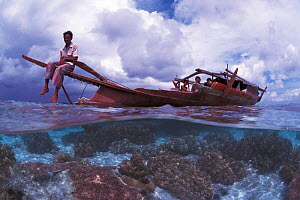 Traditional Bajau lepa boat with carving, Malaysia. Bajau people live in houses on stilts or are nomadic in houseboats.  -  Jurgen Freund