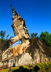Buddhist and giant stone statue of Reclining Buddha at Xieng Khuan, Vientiane, Laos South East Asia - Gavin Hellier