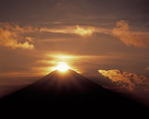 Y-7205 Mount Fuji with sun rising behind peak, Honshu, Japan. - Aflo