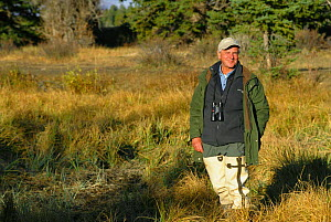 Mike Salisbury, BBC series producer of 'Life of Mammals' 200 on location at beaver site  -  Neil Lucas