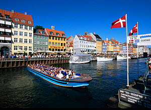 Nyhavn Waterfront District with cafes and restaurants, and ferry boat, Copenhagen, Denmark  -  Gavin Hellier
