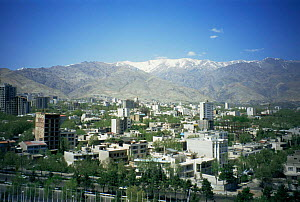 View across Tehran city, with Alborz Mountains in background, Iran, 1998 - NIGEL MARVEN
