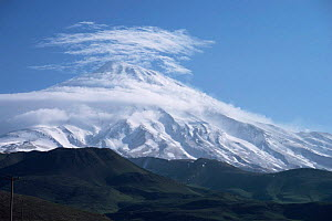 Clouds forming over Mt Damavand capped in snow, Iran, 1998 - NIGEL MARVEN