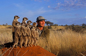 Simon King + Suricates / Meerkats {Suricata suricatta} during filming, South Africa  -  Marguerite Smits Van Oyen