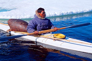 Inuit hunter in kayak with hunting gear including sealskin float, Canadian Arctic  -  DOC WHITE