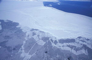 Aerial view of sea ice, spring, Svalbard, Norway. Open sea (top) solid white ice floe (middle)  -  Doug Allan