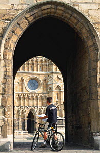 Cyclist in archway of cathedral, Lincoln, England.  -  Julia Bayne