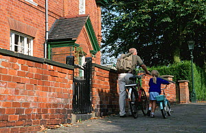 Man taking child to school on bicycle, Leicestershire, England  -  Julia Bayne