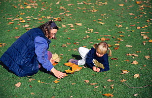 Mother and child collecting leaves  -  Julia Bayne