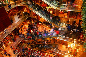 Christmas shoppers on escalators in Trump Tower shopping centre, New York, USA  -  Phil Savoie