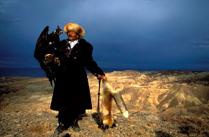 Kazakh hunter with Golden eagle + dead fox hunted for fur, Kazakhstan, Asia  -  VINCENT MUNIER