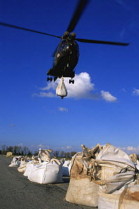 Helicopter dropping sand sacks, dam breach of Rhone, Arles, Camargue, France, December 2003 - Jean E. Roche