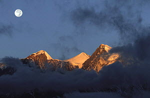 Full moon at sunrise on snow-capped mountains. View from Muktinath, Mustang, Nepal November 2004  -  Bernard Castelein