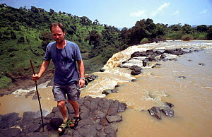 Richard Kirby (cameraman) stands at top of Tisasat Falls on Blue Nile, Ethiopia  -  George Chan
