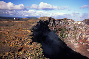 People hiking Mauna Loa (long mountain) earth's largest volcano Big Island Hawaii  -  Photo Resource Hawaii