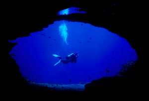 Scuba diver explores lava tubes in Hawaii's underwater world Oahu Hawaii Pacific  -  Photo Resource Hawaii