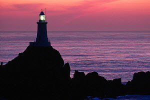 Corbiere lighthouse at sunset, Jersey, Channel Islands  -  Michael Pitts