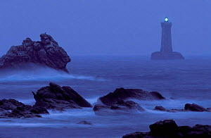 Four lighthouse at night in stormy weather, Brittany, France  -  Christophe Courteau