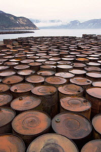 Rusting barrels, relics of submarine base, Shimushir Is, Kuril Is, Kamchatka, E Russia  -  Pete Oxford